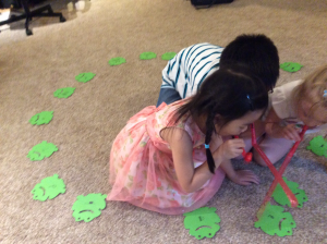 My birthday students along with my daughter (I always call her if it's an appropriate game she'd enjoy) playing KISSING FROGS.